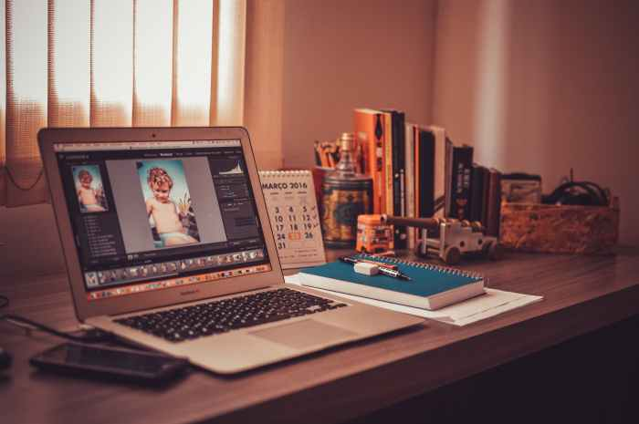 books notebook macbook table